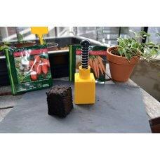 Sprava za oblikovanje briketa od treseta za sijanje i sadnju